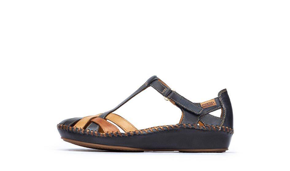 P.Vallarta.655-0732C5. Sandalia atada al tobillo con cierre de velcro, refuerzo en el talón y punta cerrada, con costuras hechas a mano.