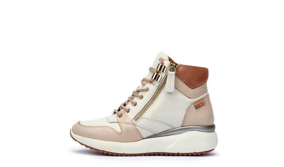 Leather ankle boots that combine a sneaker cut with a wedge sole.